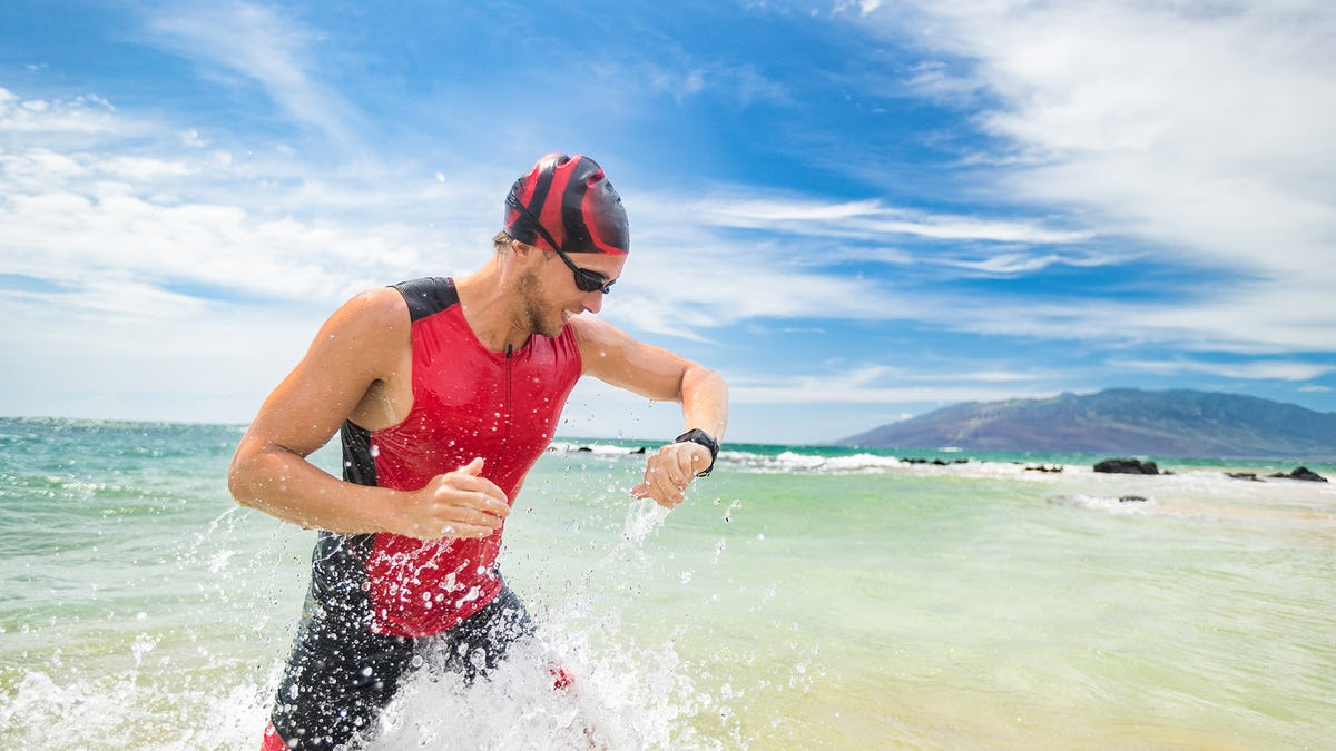 A swimmer checking his fitness tracker
