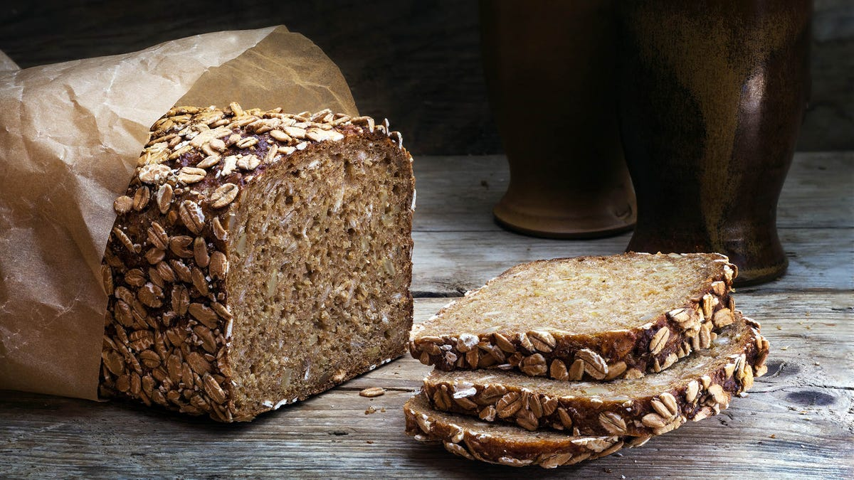 Freshly sliced whole grain bread with oats