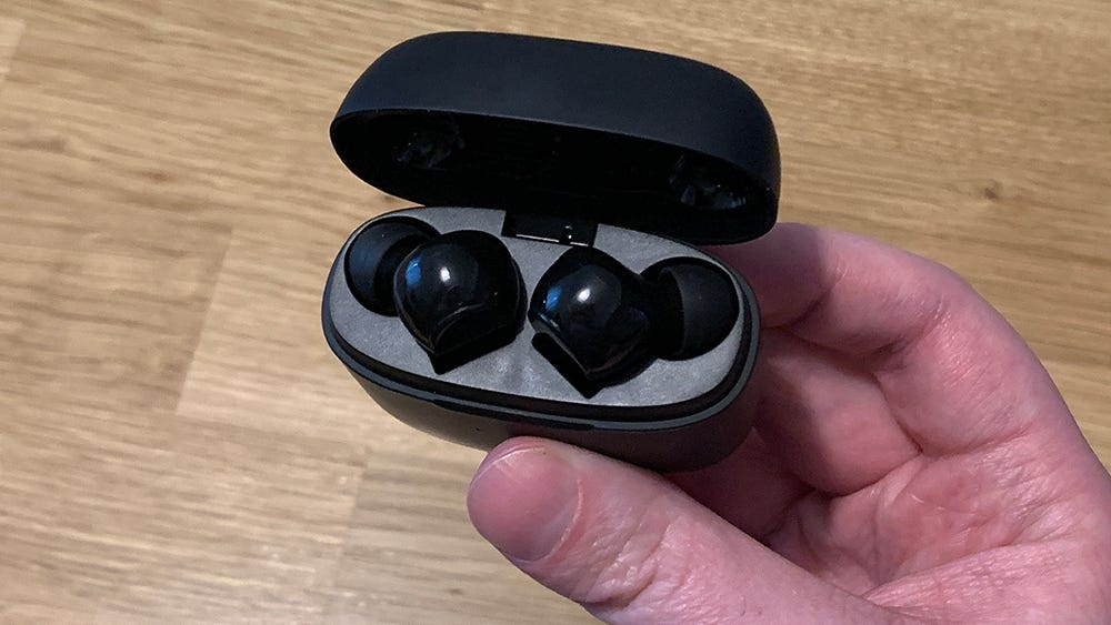 Liberty Air headphones tucked into the charging case