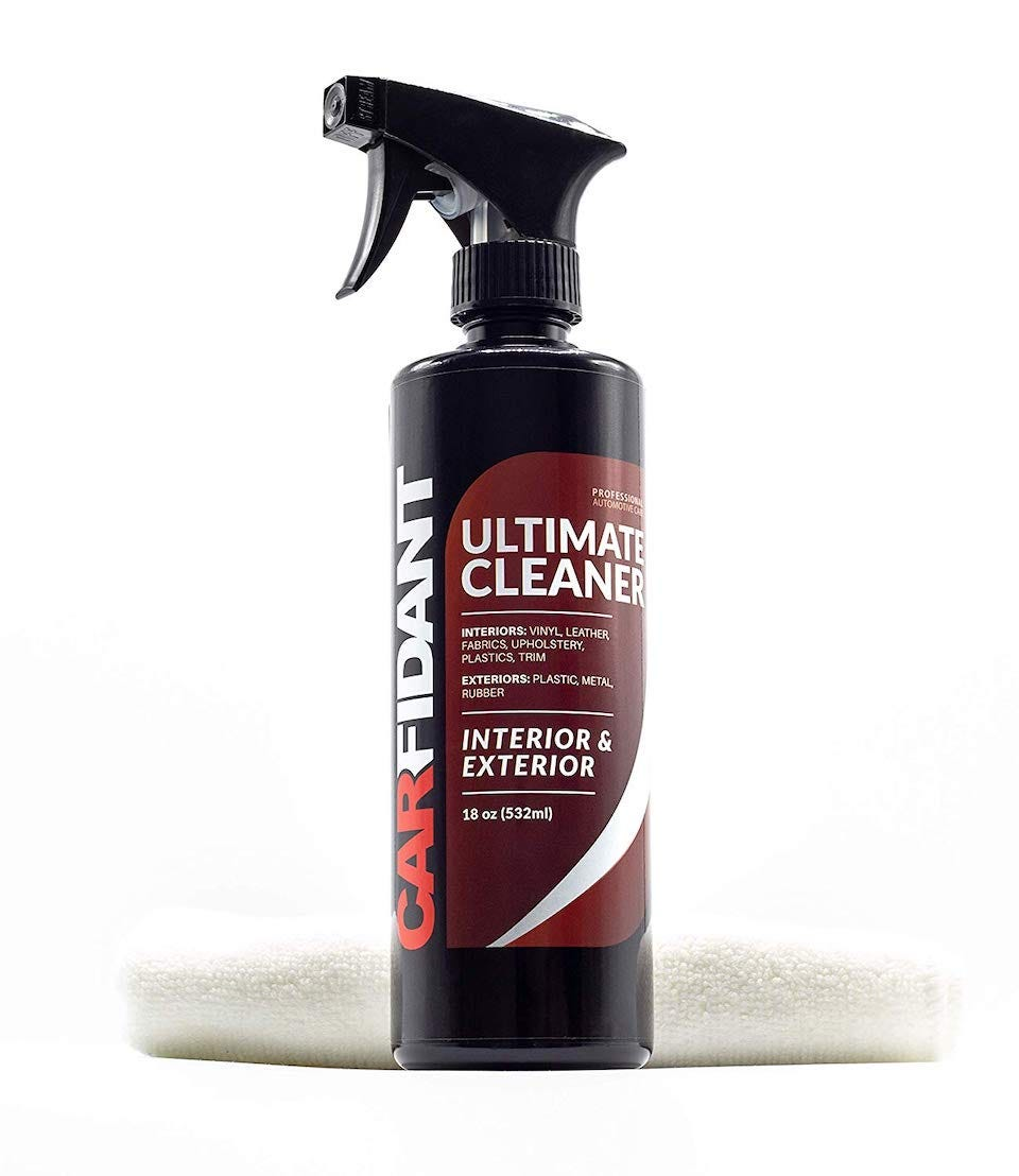 Bottle of Carfidant Ultimate Cleaner with a white microfiber cloth