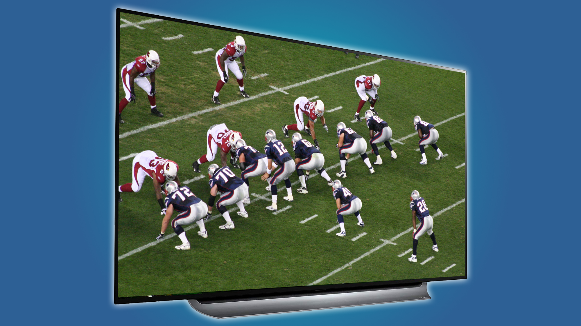 Large screen television displaying a football game in progress