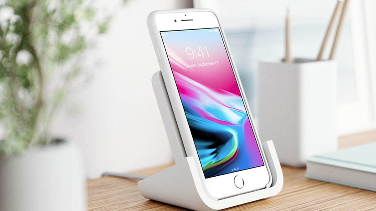 Logitech Powered wireless charger with an iPhone 8 resting on it
