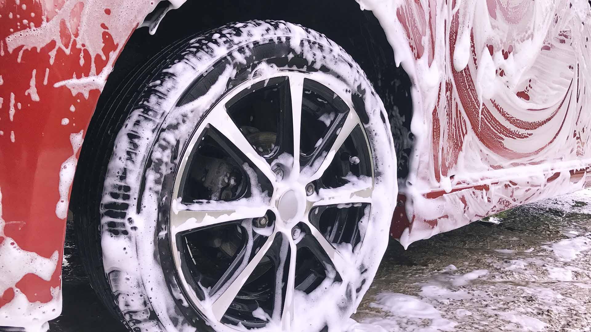 Car wheel and rim, sudsy during car washing