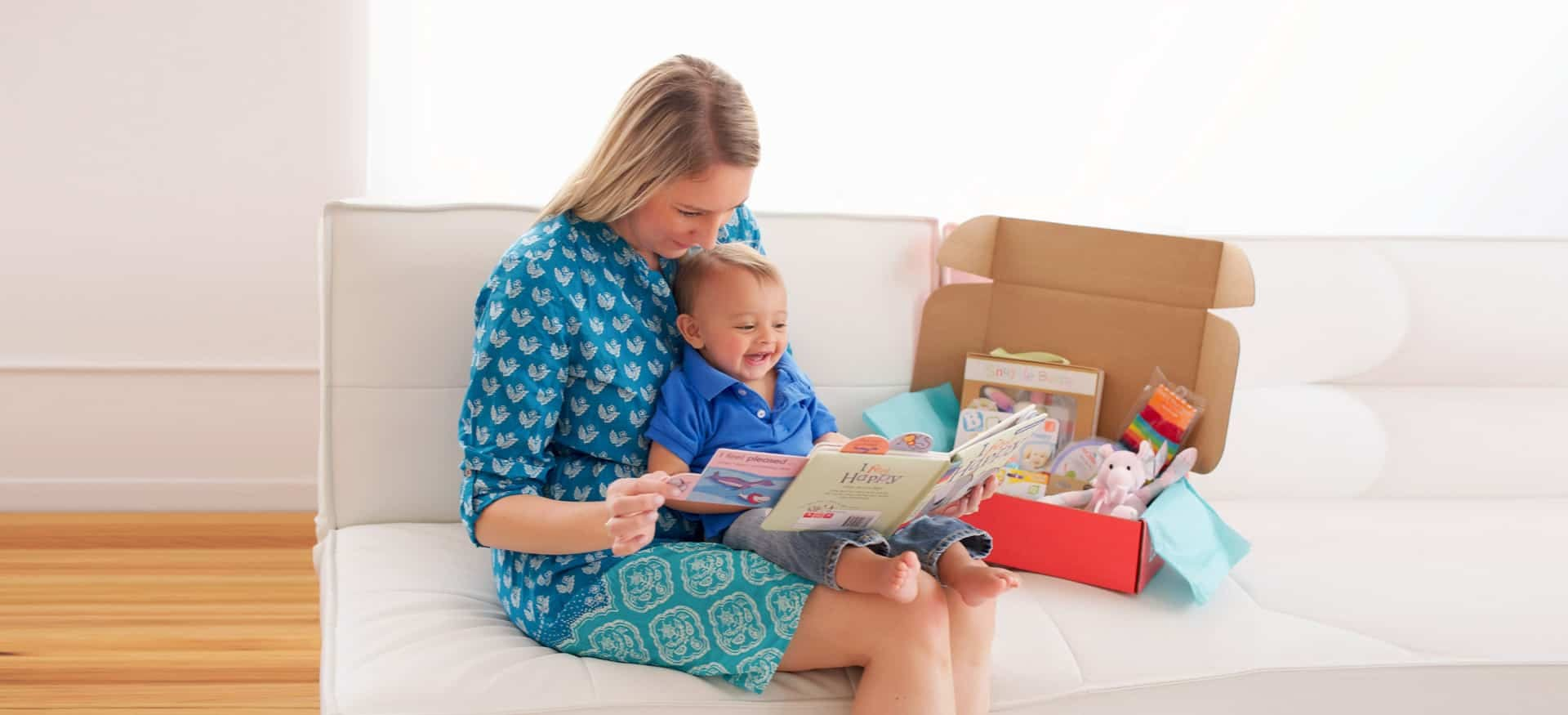 Mother opening a Bluum subscription box with her child
