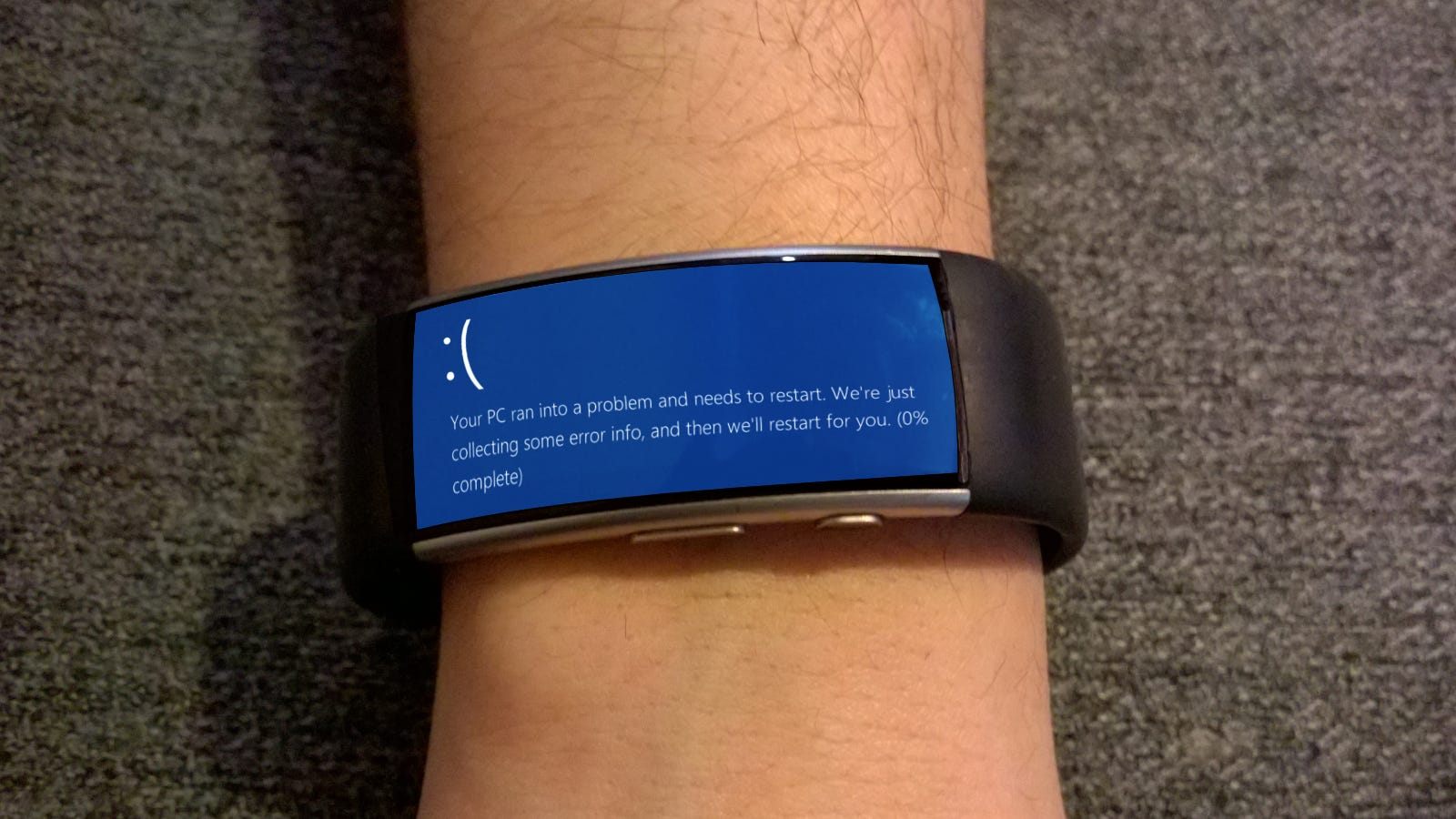 A Microsoft band with a blue screen of death