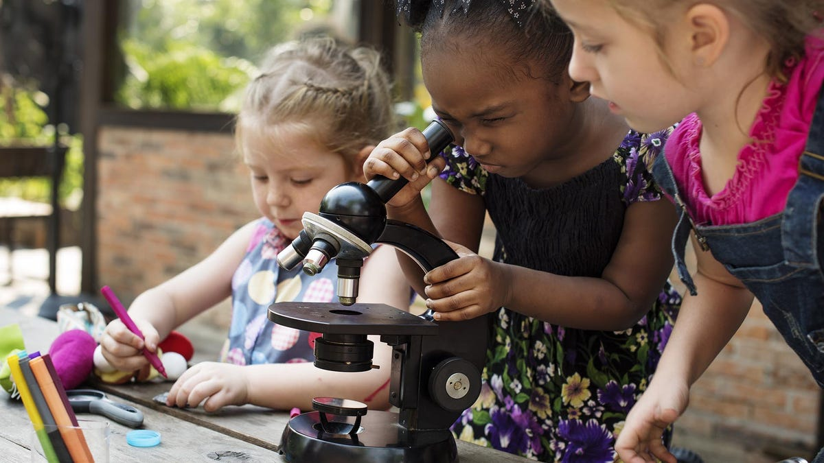 Young Kids Using Microscope Learning Science Class