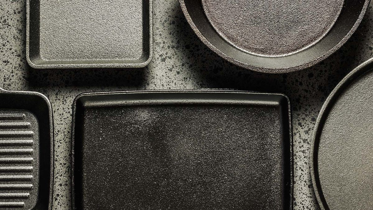 Cast iron pans on a counter top