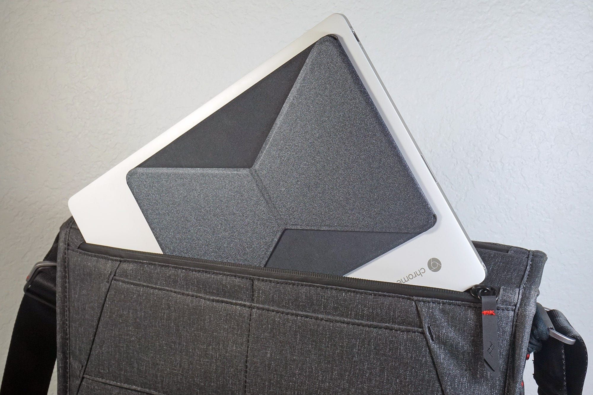 When folded down, the kickstand adds almost no bulk. It's easy to slip into my bag.