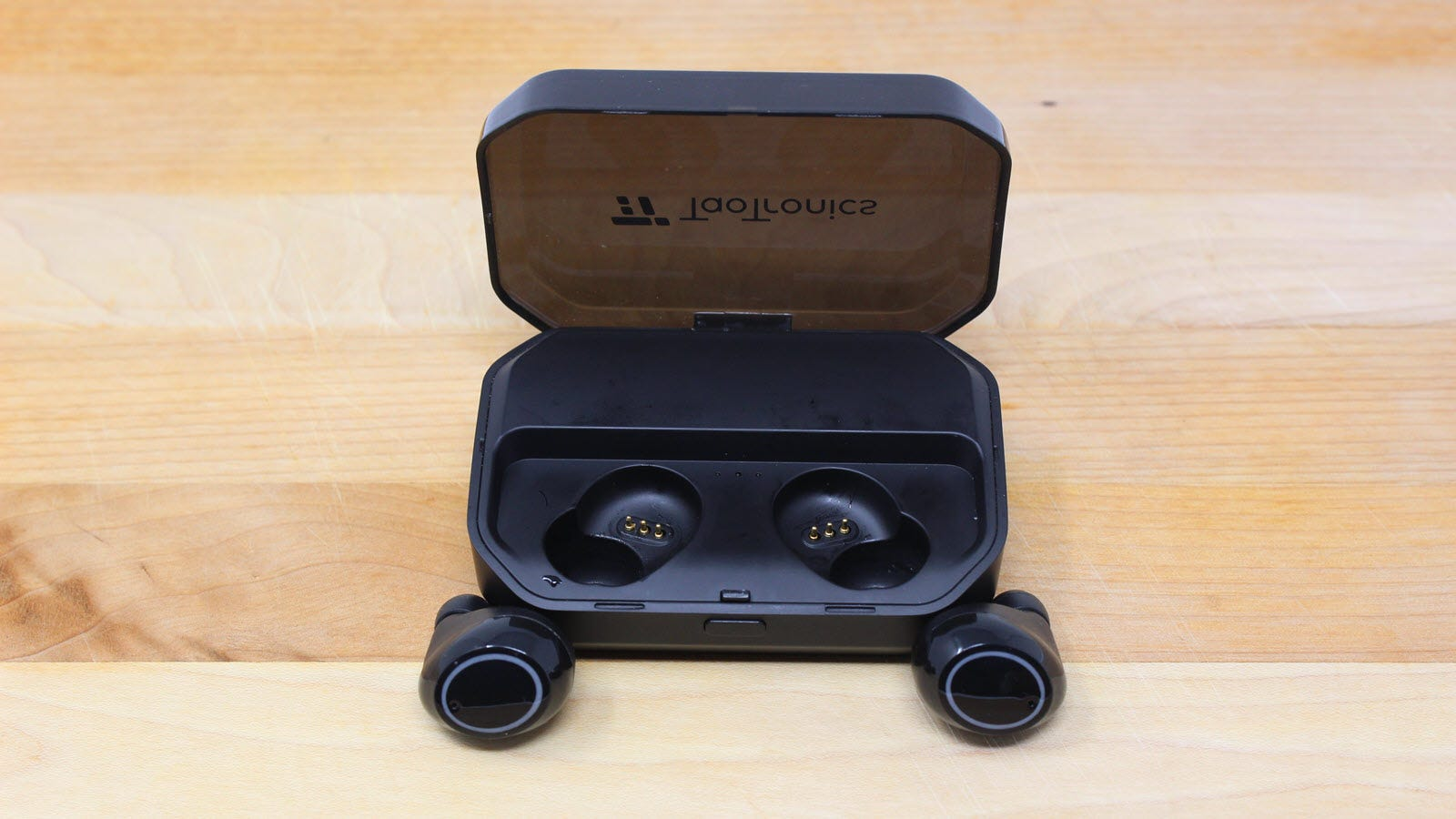 A topview of TaoTronics Earbuds and their case.
