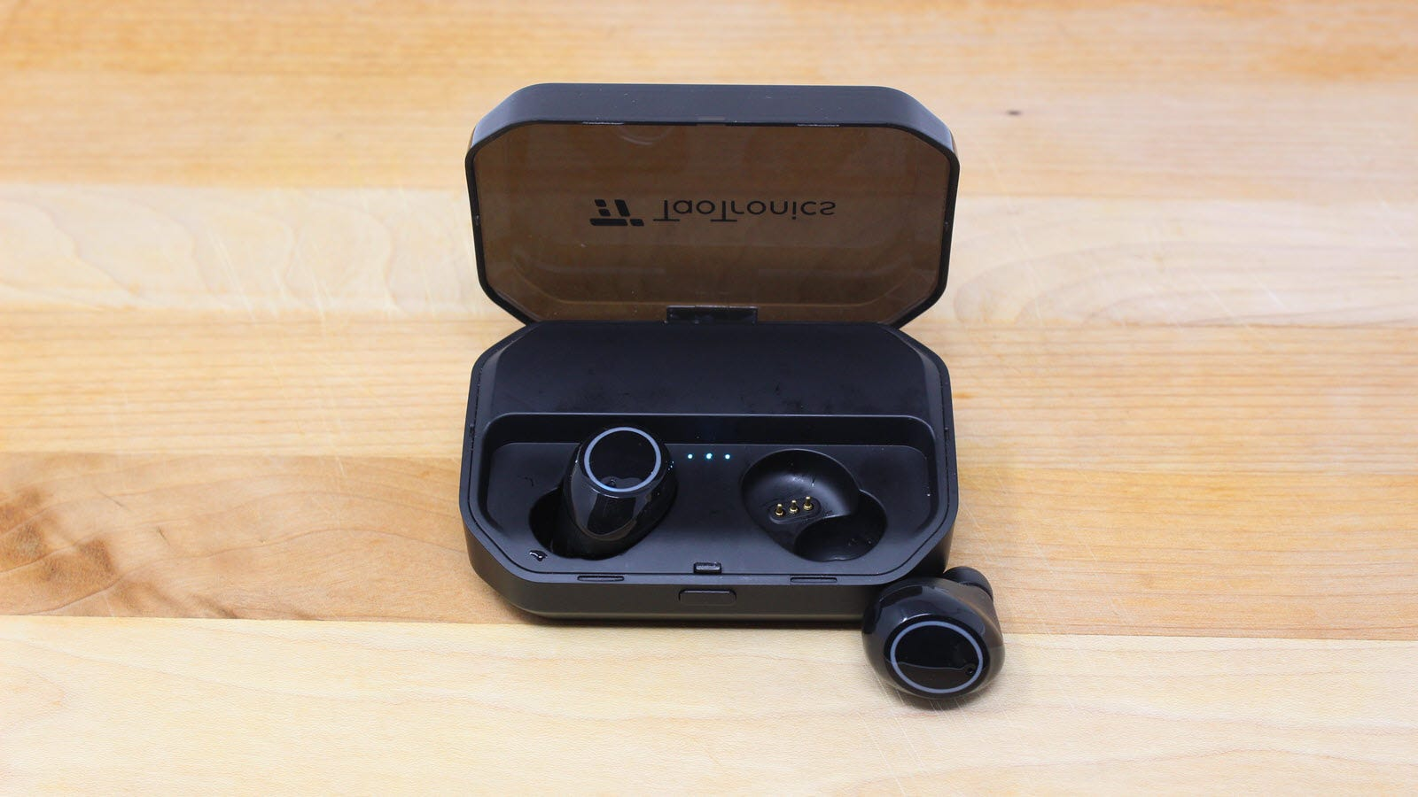 TaoTronics earbuds, with one earbud out of the case.