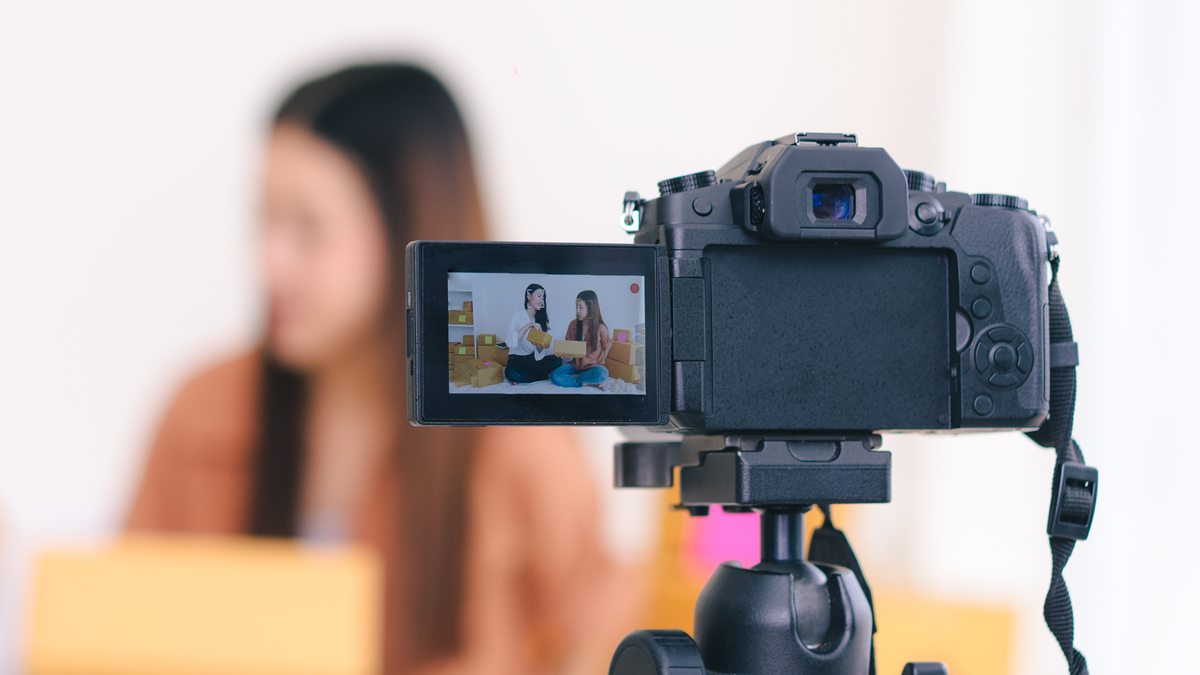 Digital video camera recording an interview between two women