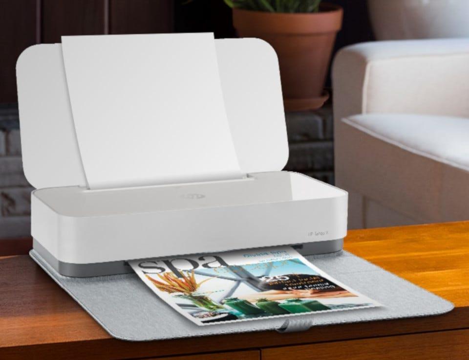 The HP Tango X printer on a coffee table.