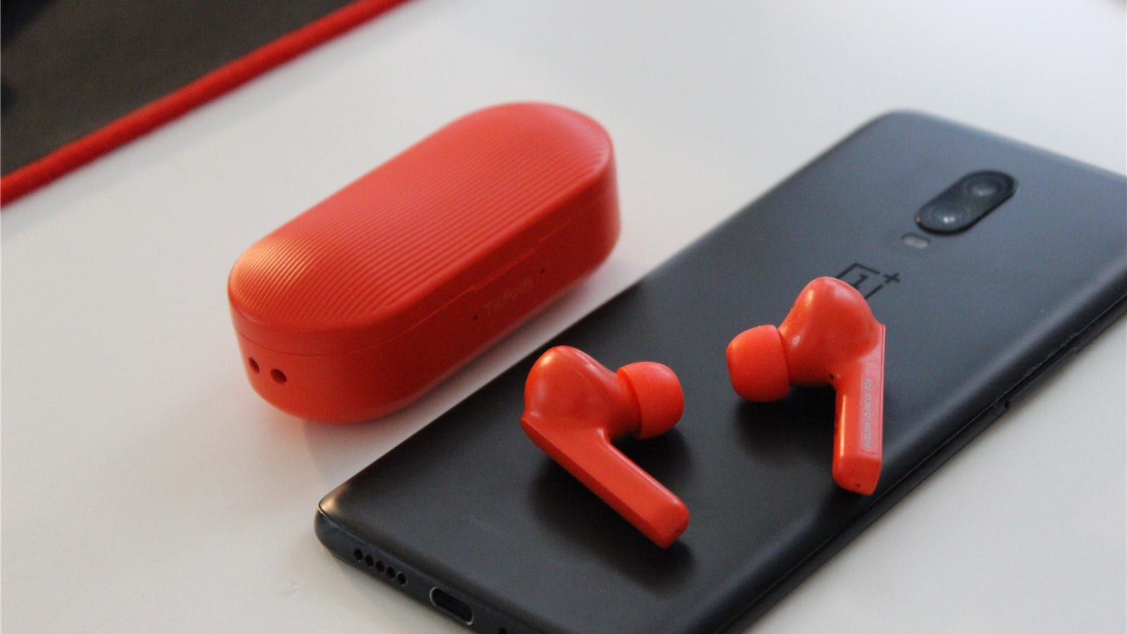 TicPods lying on the OnePlus 6T