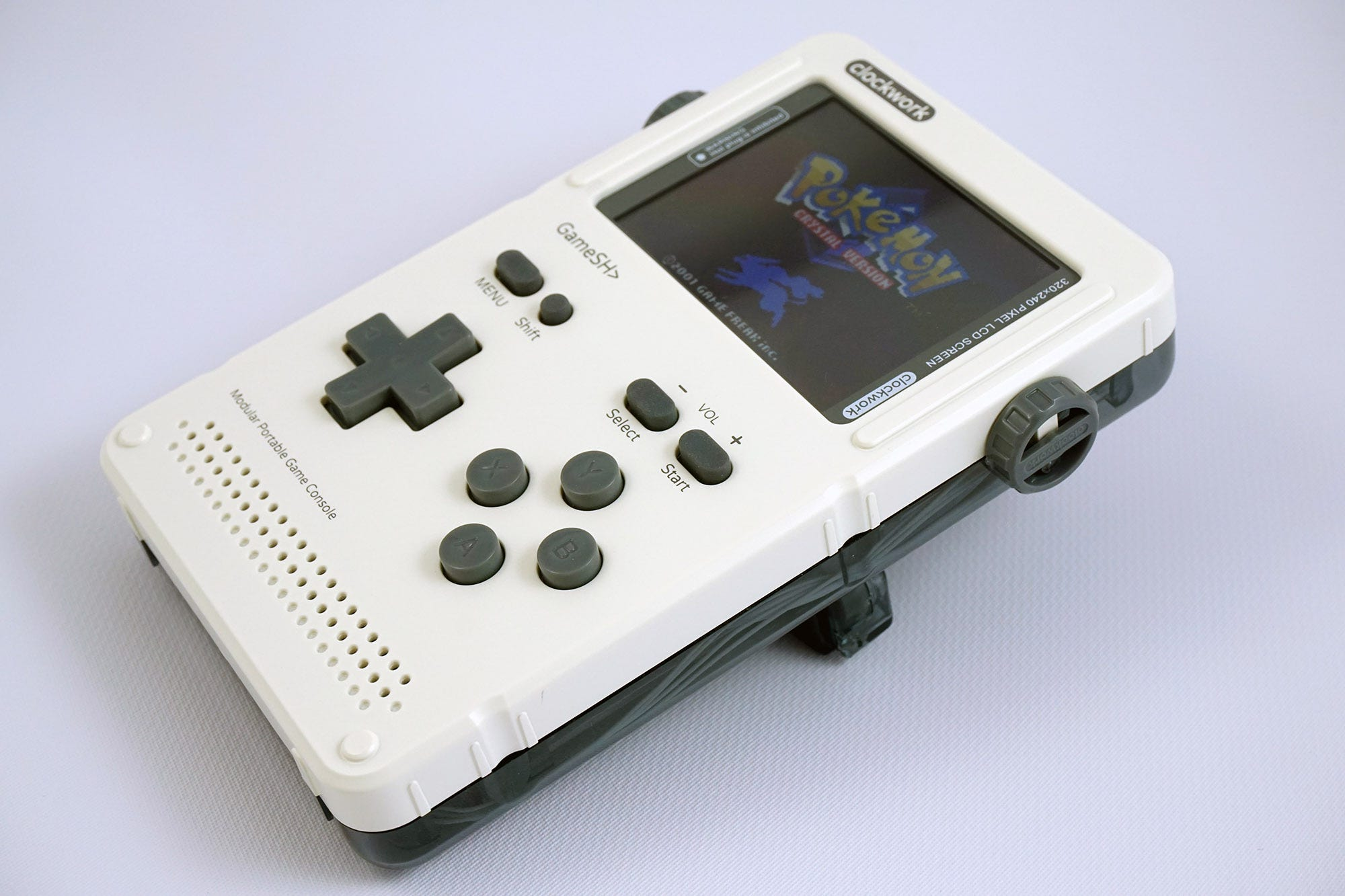 The GameShell, running a Game Boy emulator, with the extra button bar in place.
