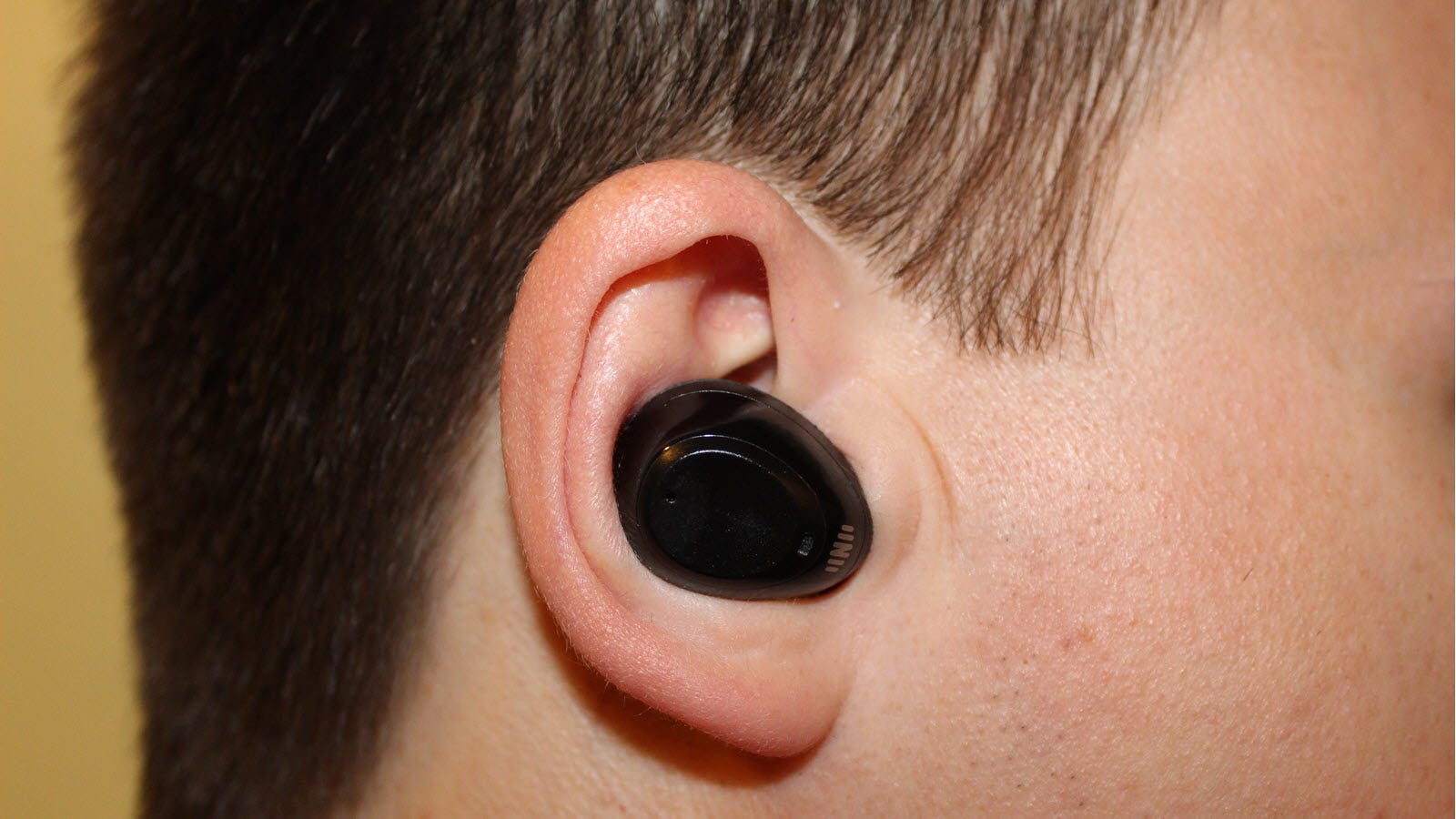 Nuheara IQBuds Boost in an ear, showing relative size.