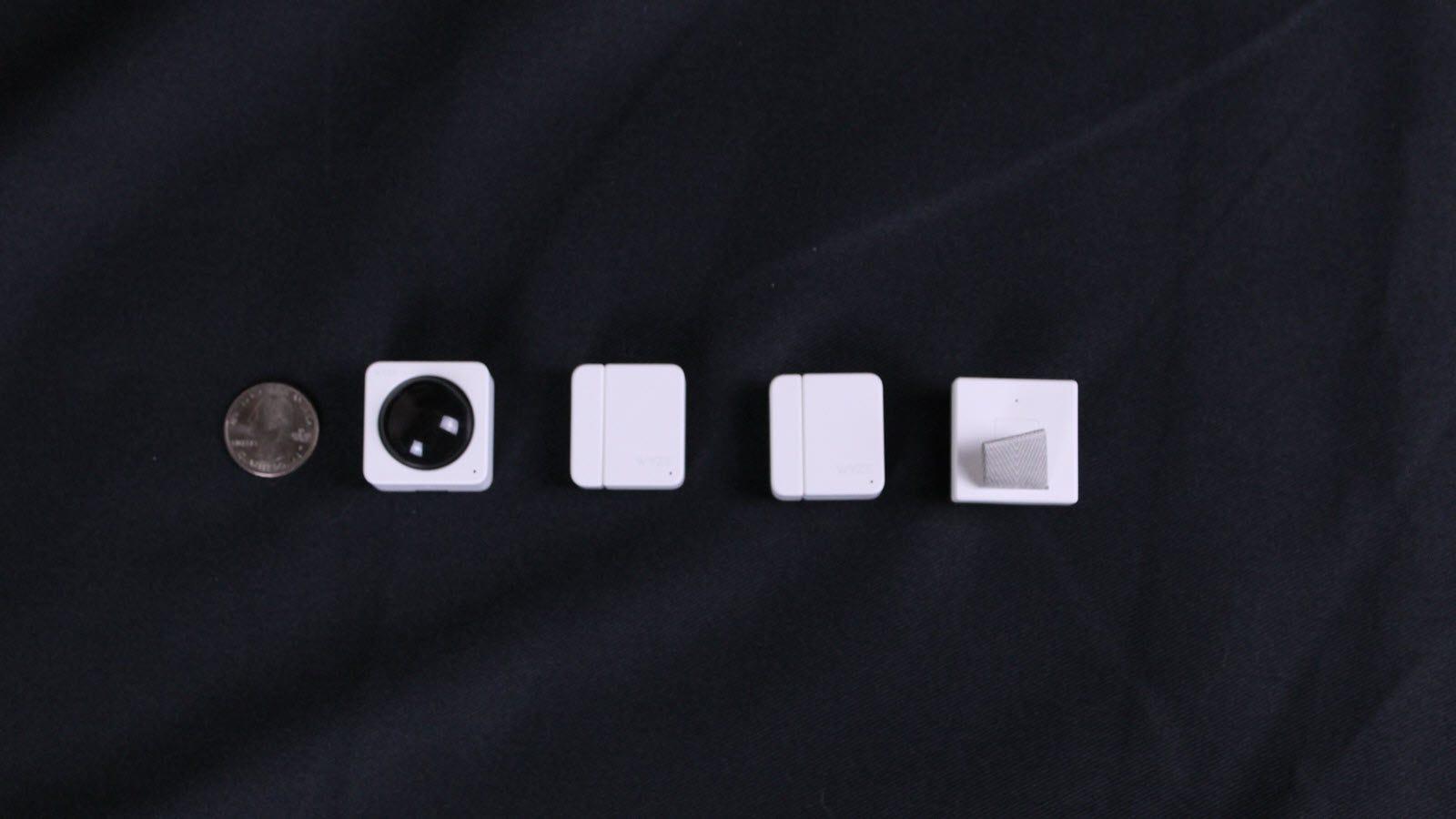 Wyze Sense nexto to a quarter, showing a comparable size.