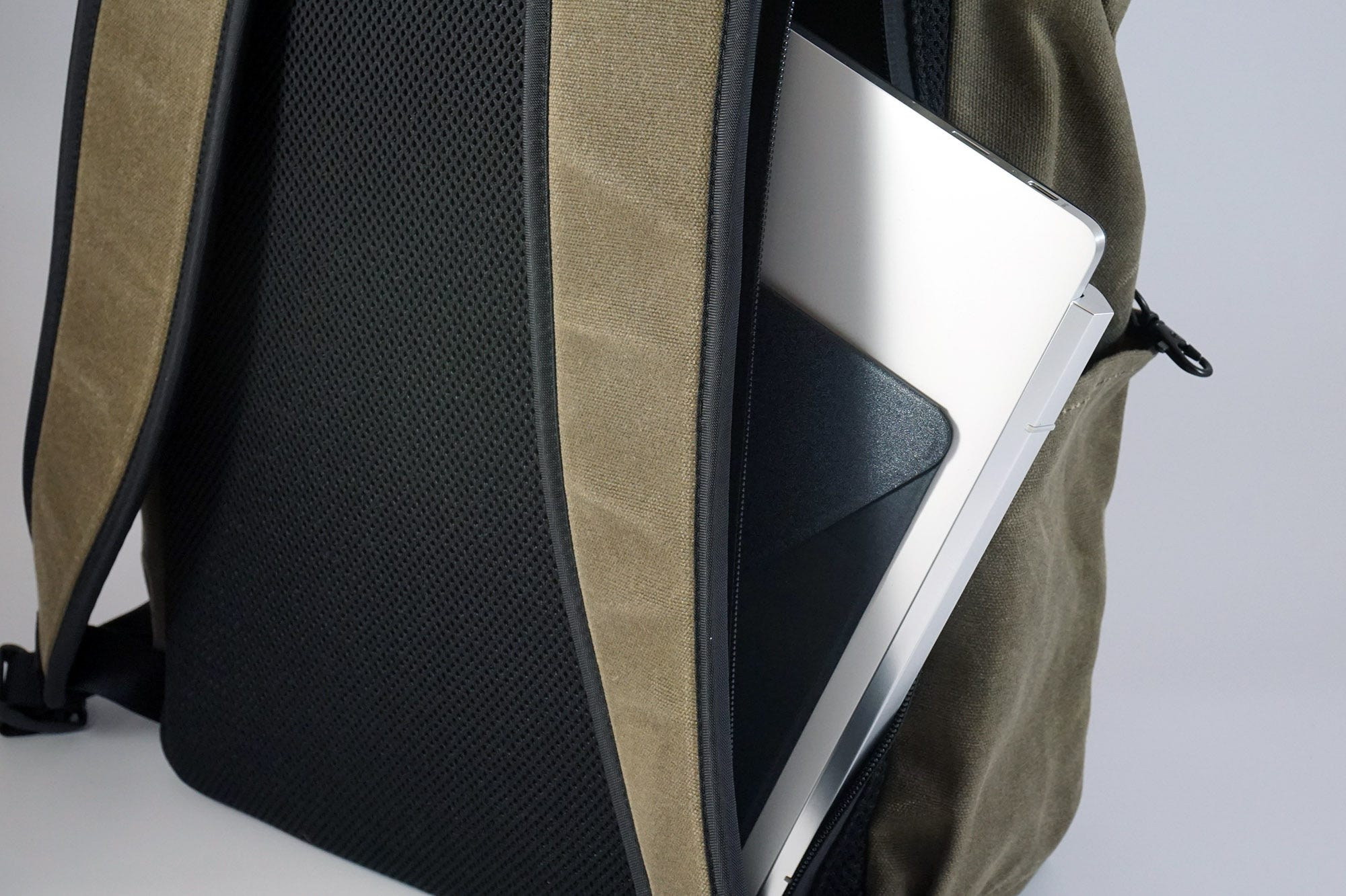 A tough, zippered pocket on the back offers easy access to a laptop.