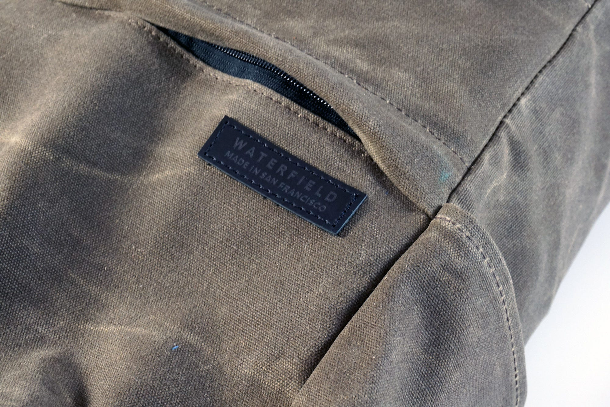 The Tech Rolltop's material is a tough, heavy waxed canvas.