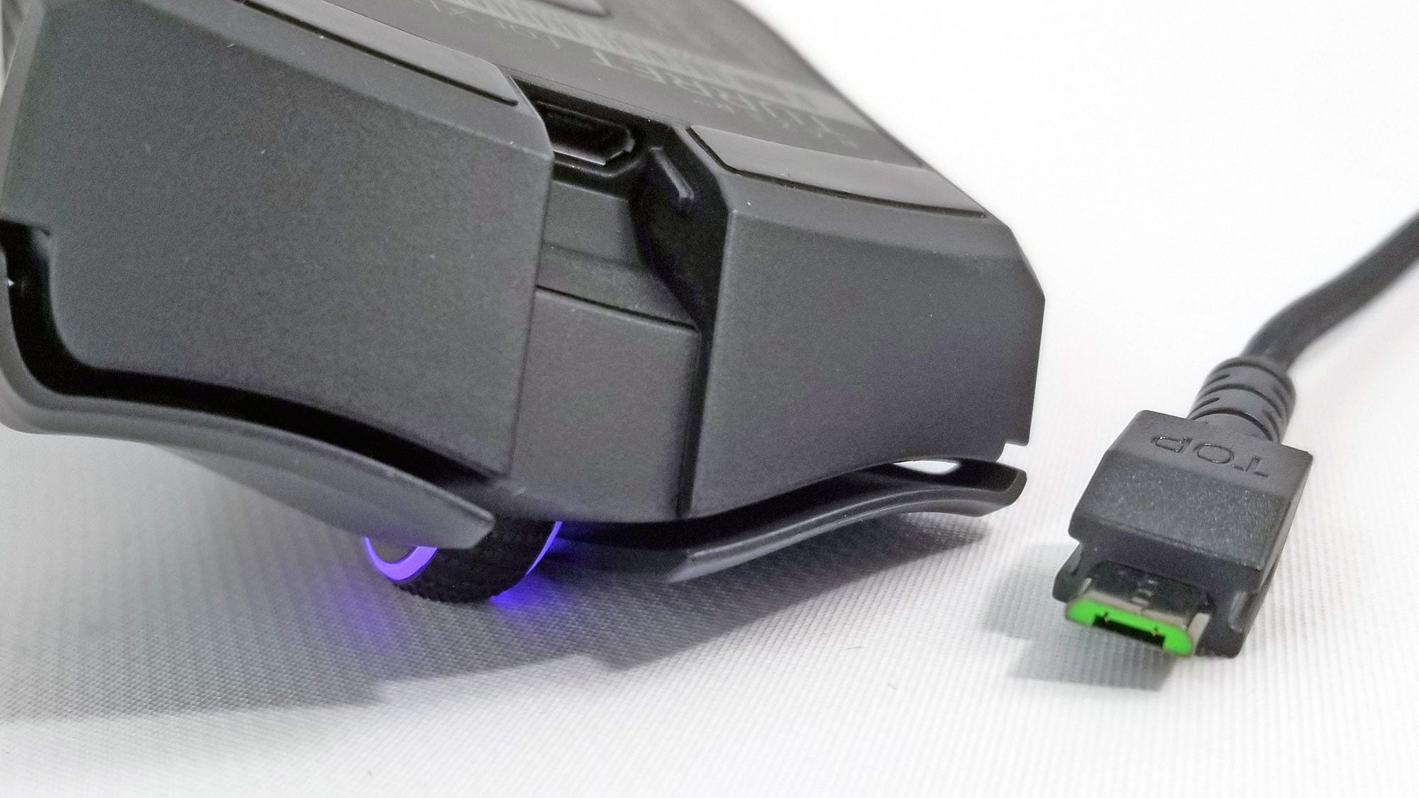 The mouse in the Razer Turret uses MicroUSB, probably so it could re-use the design of the Mamba.