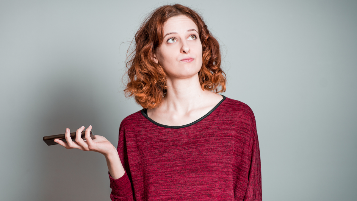 This woman is annoyed at her boring phone. Or something else, I dunno. It's a stock image.