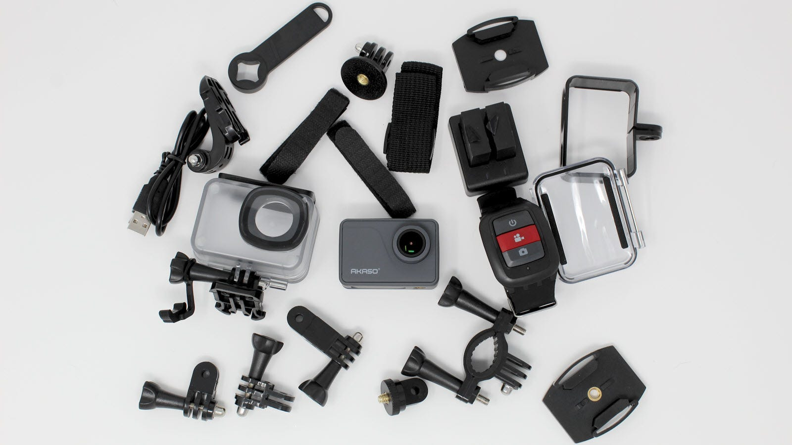 The Akaso V50, wrist remote, underwater case, mount housing, bike mounts, cables, two batteries, and other accessories.
