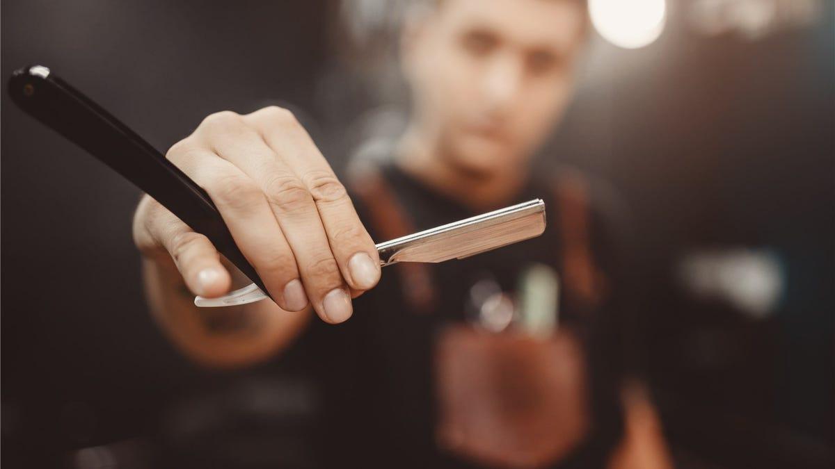 A man holding a straight razor