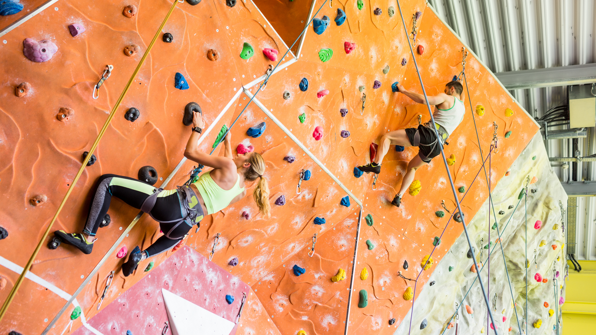 A couple indoor rock climbing.