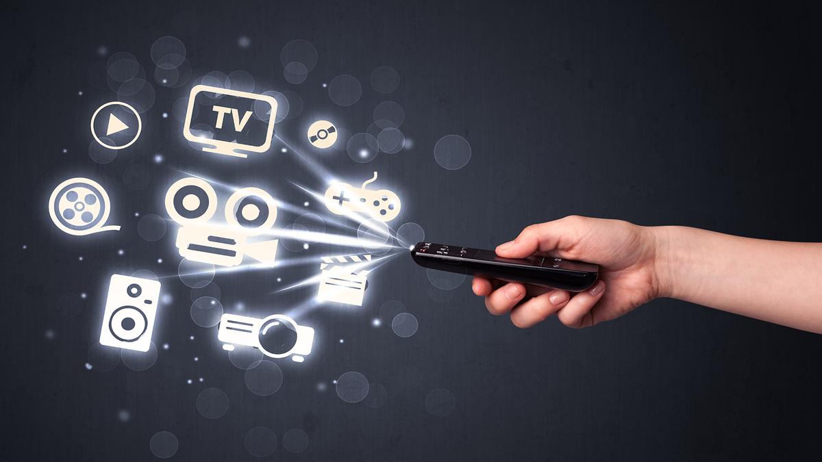 A man controls his entire media center using a single remote. It's a universal remote!