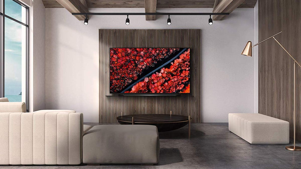 LGOLED 65-inch TV mounted to a wall in a living room.
