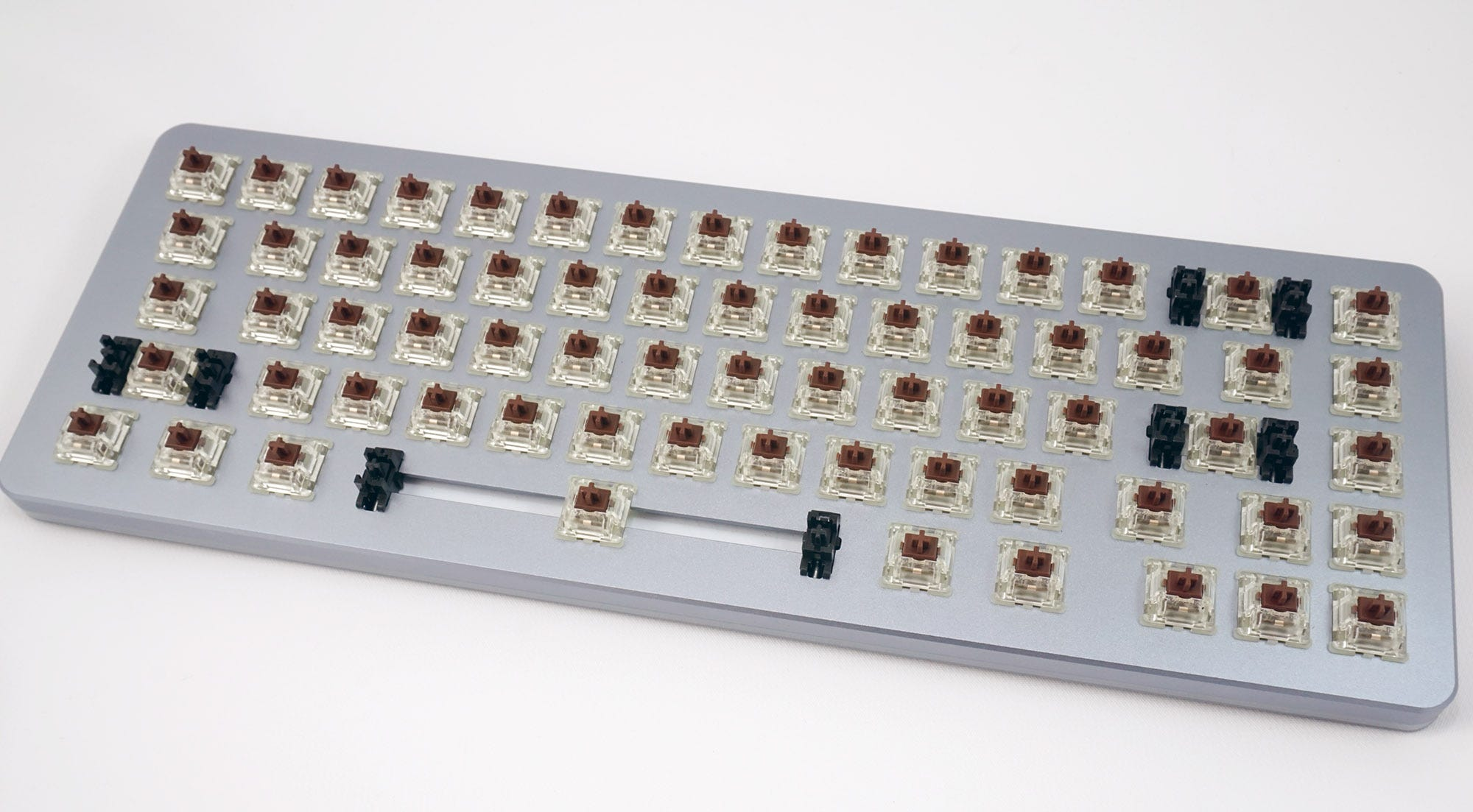 The ALT with keycaps removed and default MX Brown switches in place.
