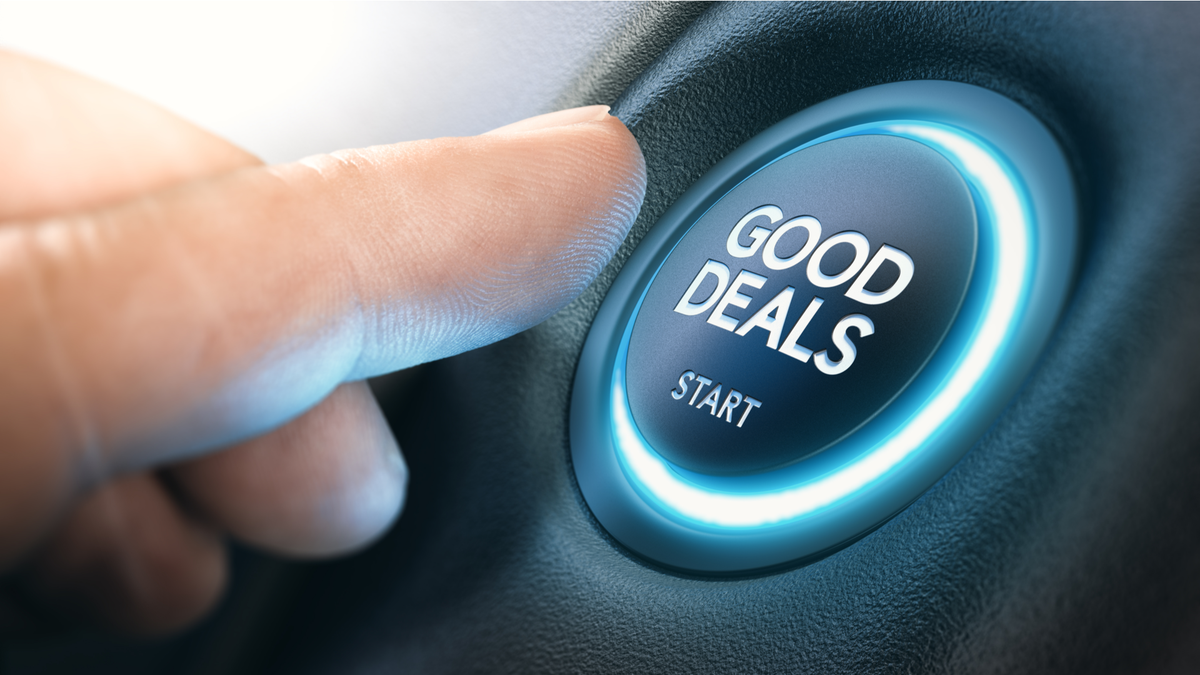 Finger pressing a car start button with the text good deals