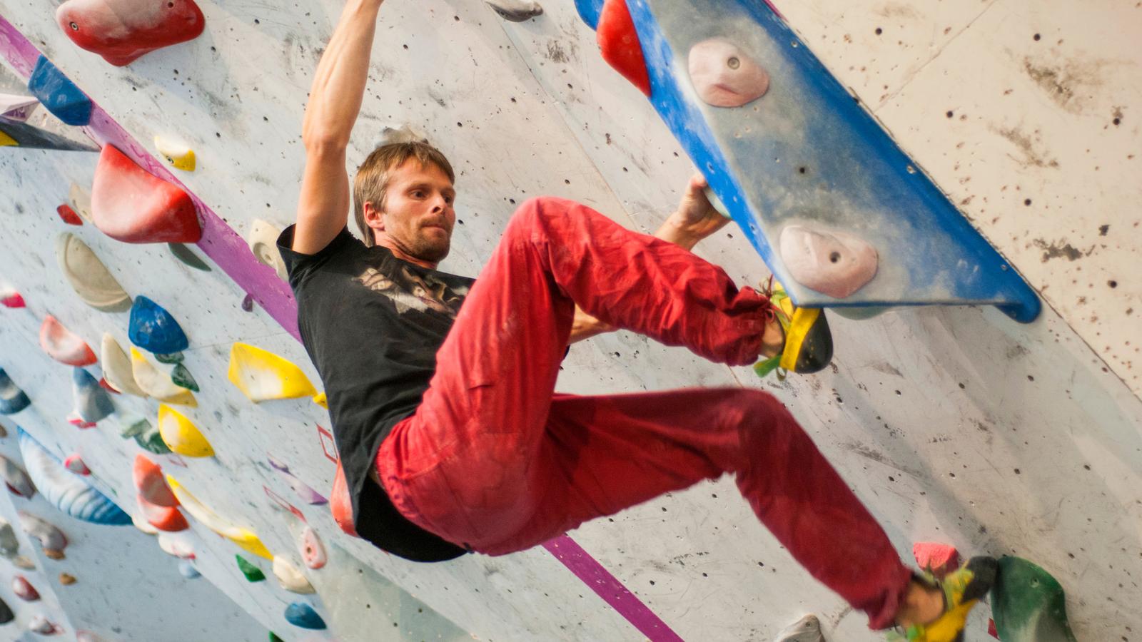 Man on a climbing wall.
