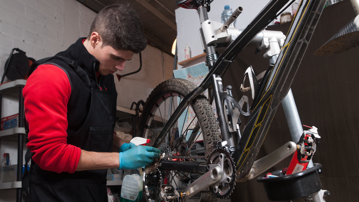 Mechanic working on a bike.