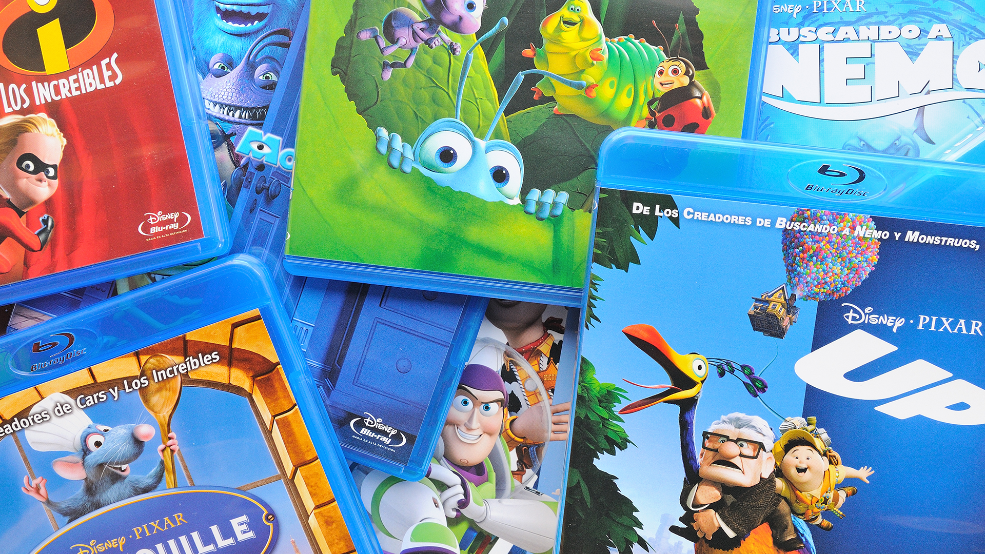 """A messy pile of Disney Blu-rays, including """"Up,"""" """"Bugs,"""" """"Finding Nemo,"""" """"Toy Story,"""" and """"Ratatouille."""""""