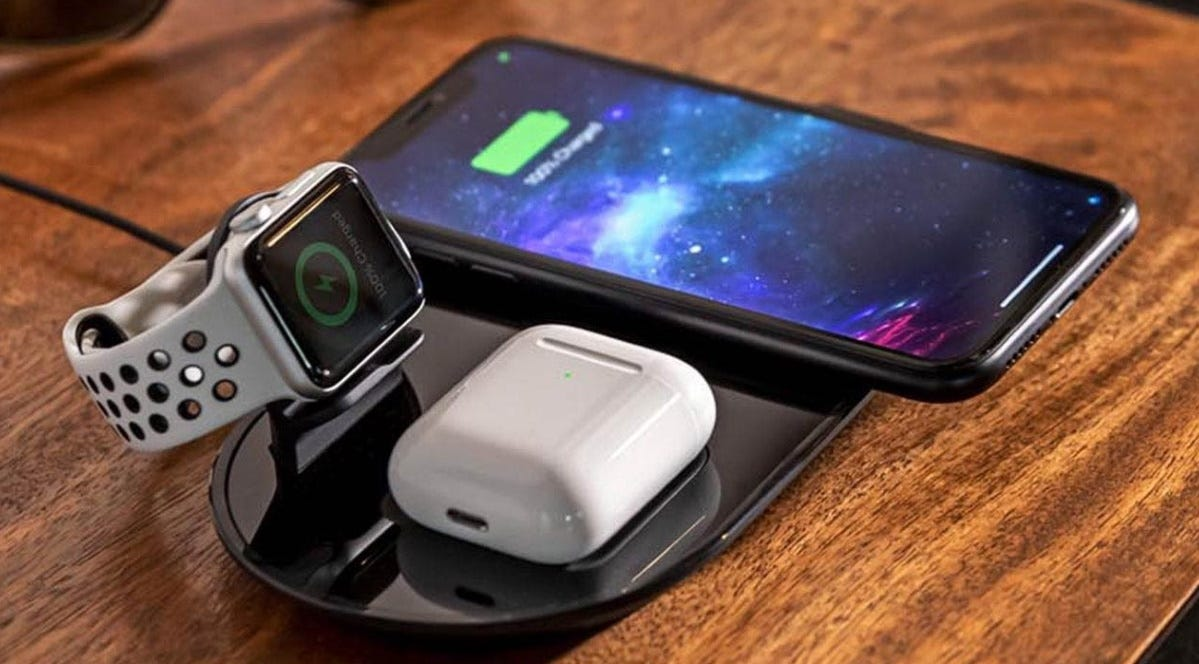 A mophie 3-in-1 Wireless Charging Pad charging an iPhone, Apple Watch, and AirPods.