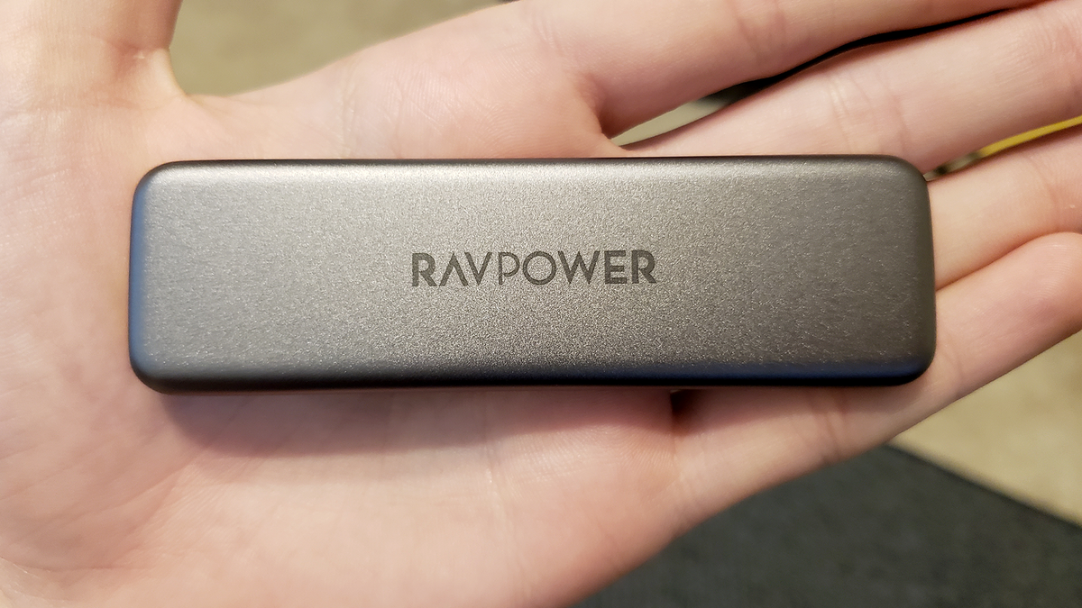The RAVPower Mini SSD in the palm of a hand. It's quite small!