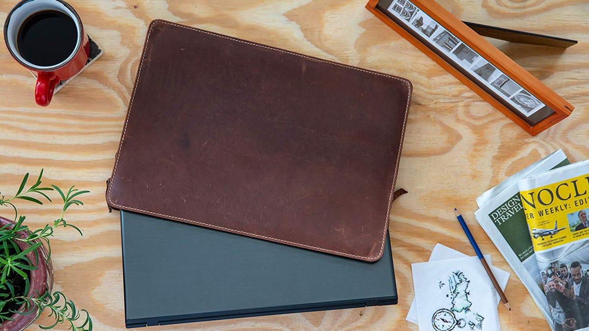Tuk Tuk Press Leather laptop Sleeve on table