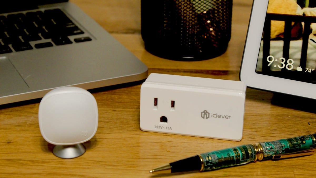 A MacBook, an ecobee sensor, a smart plug, and a Google Home Hub on a desk.