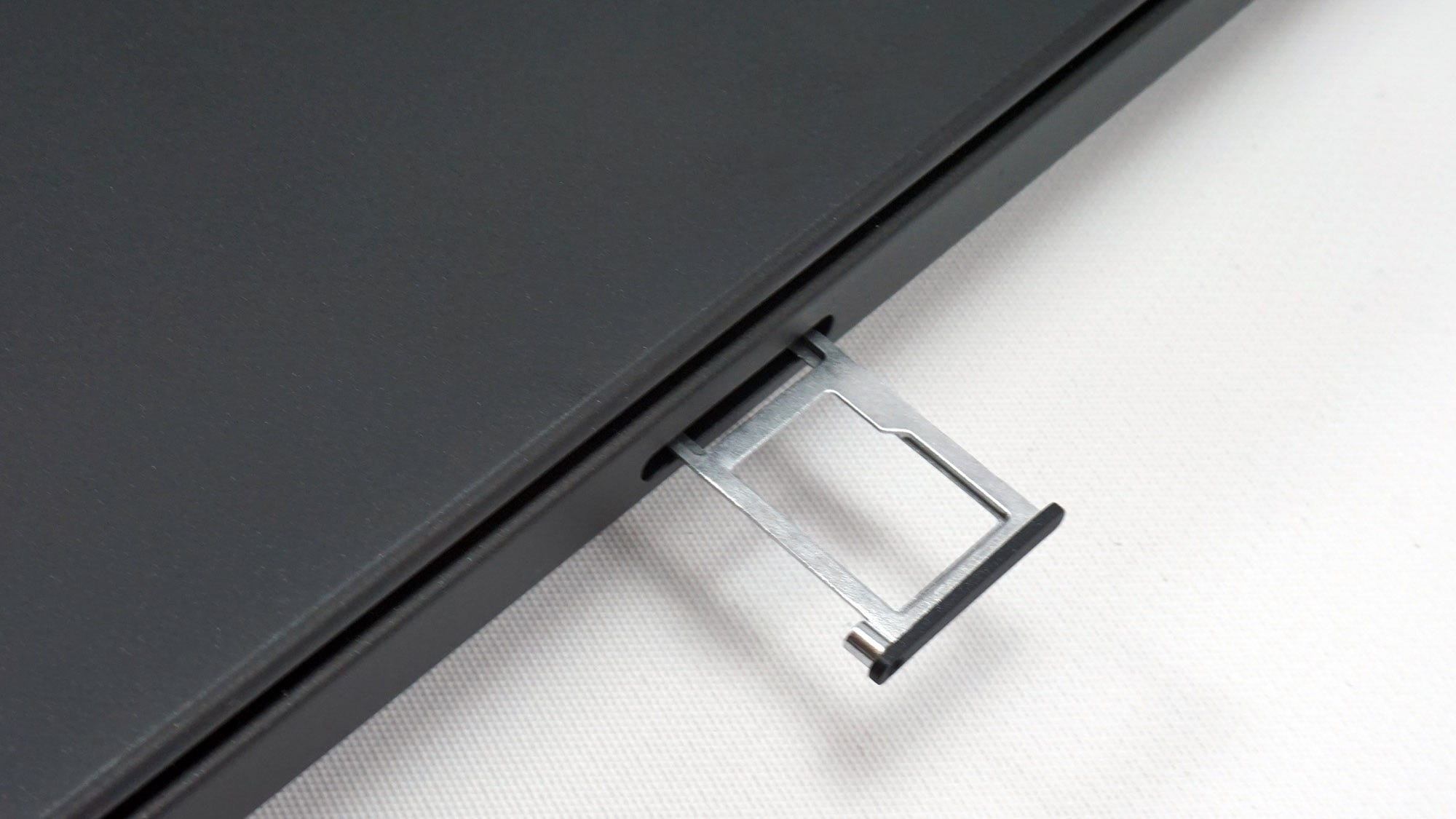 The SIM/MicroSD card tray on the back of the T490s.