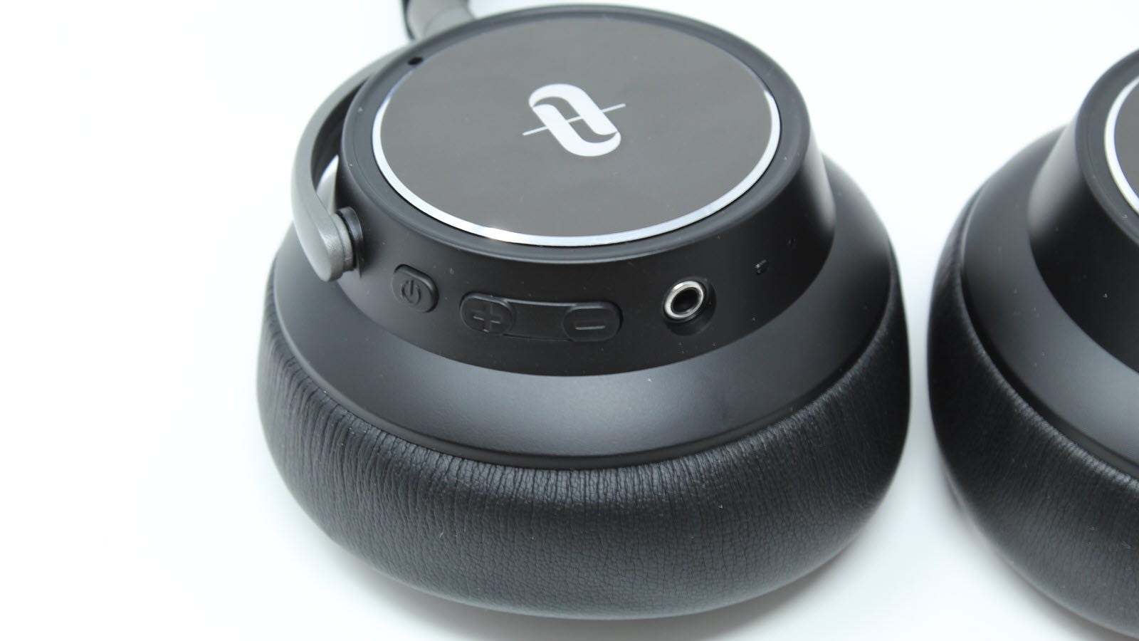 A closeup of the Headphones showing Power, volume up and down, and headphone jack.