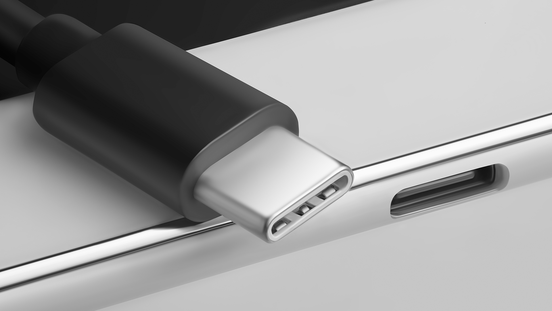 A USB-C cable sitting on top of a computer case.