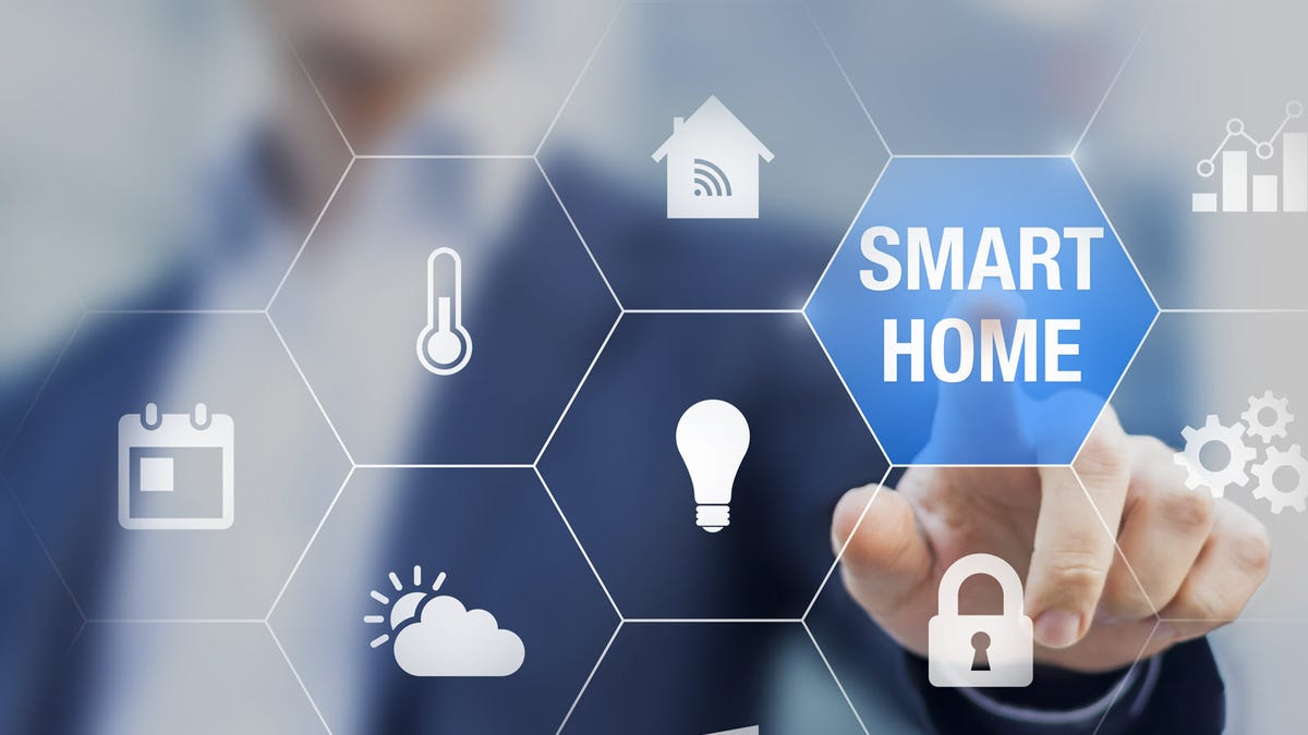 mart home automation concept with icons showing the functionalities of this new technology and a person touching a button