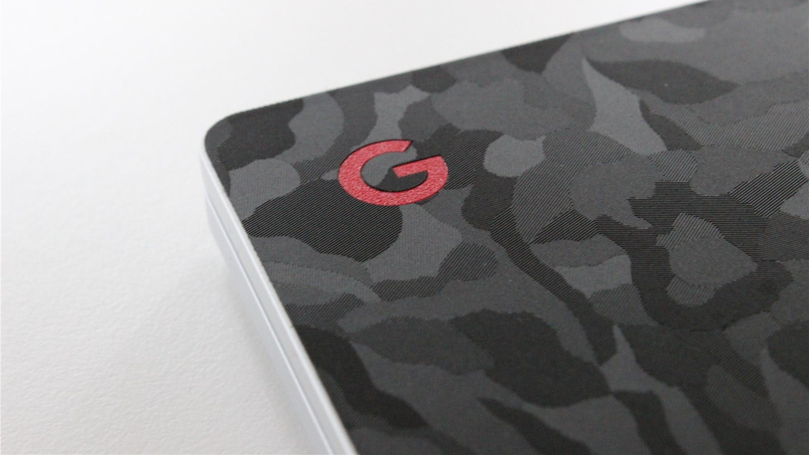dbrand Black Camo with a red Google logo on the Pixlebook