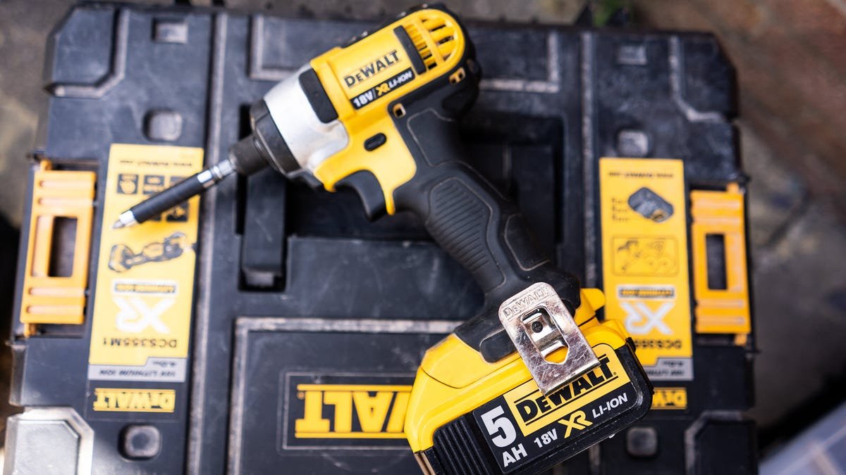 A DEWALT Impact Driver left on a tool chest.