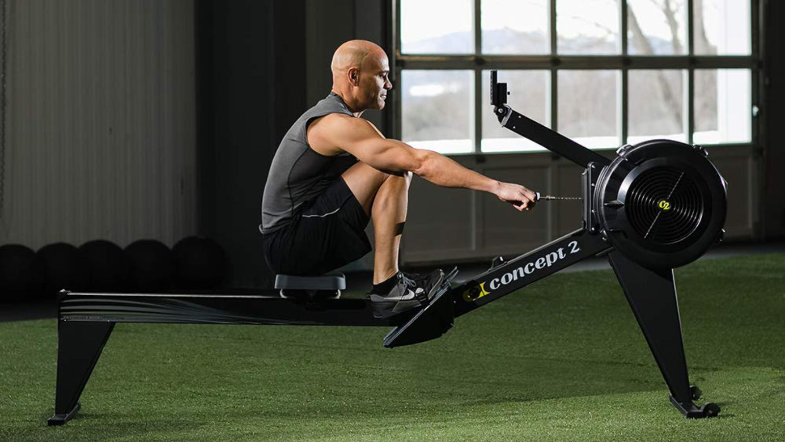 Man Using Concept2 Model E Rower