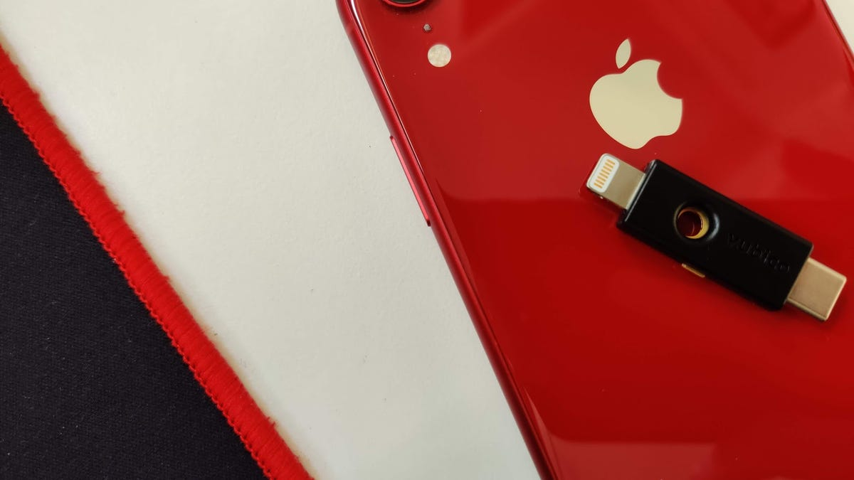 The YubiKey 5Ci on the red iPhone XR.