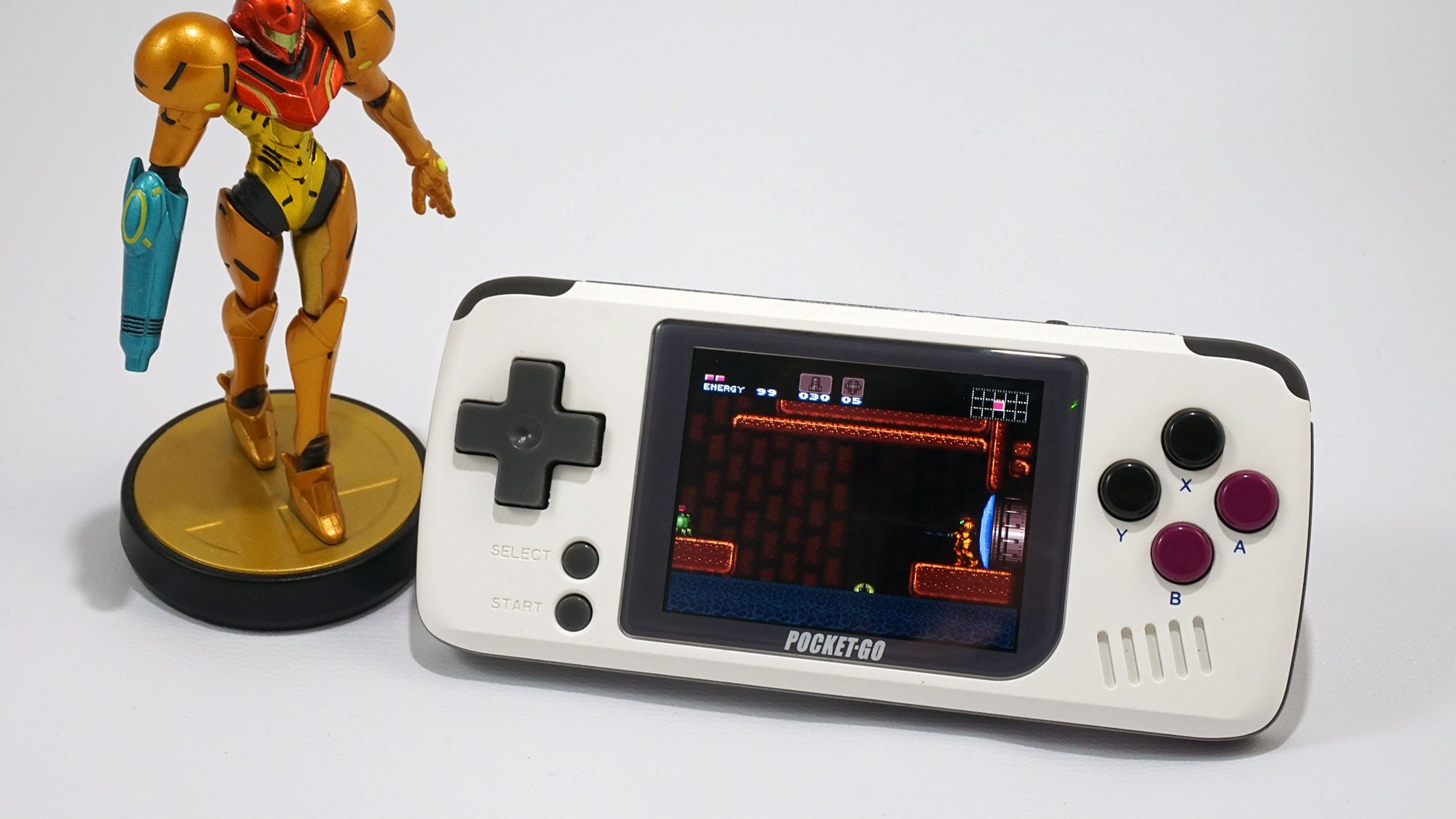 The PocketGo portable game console with a Metroid amiibo.