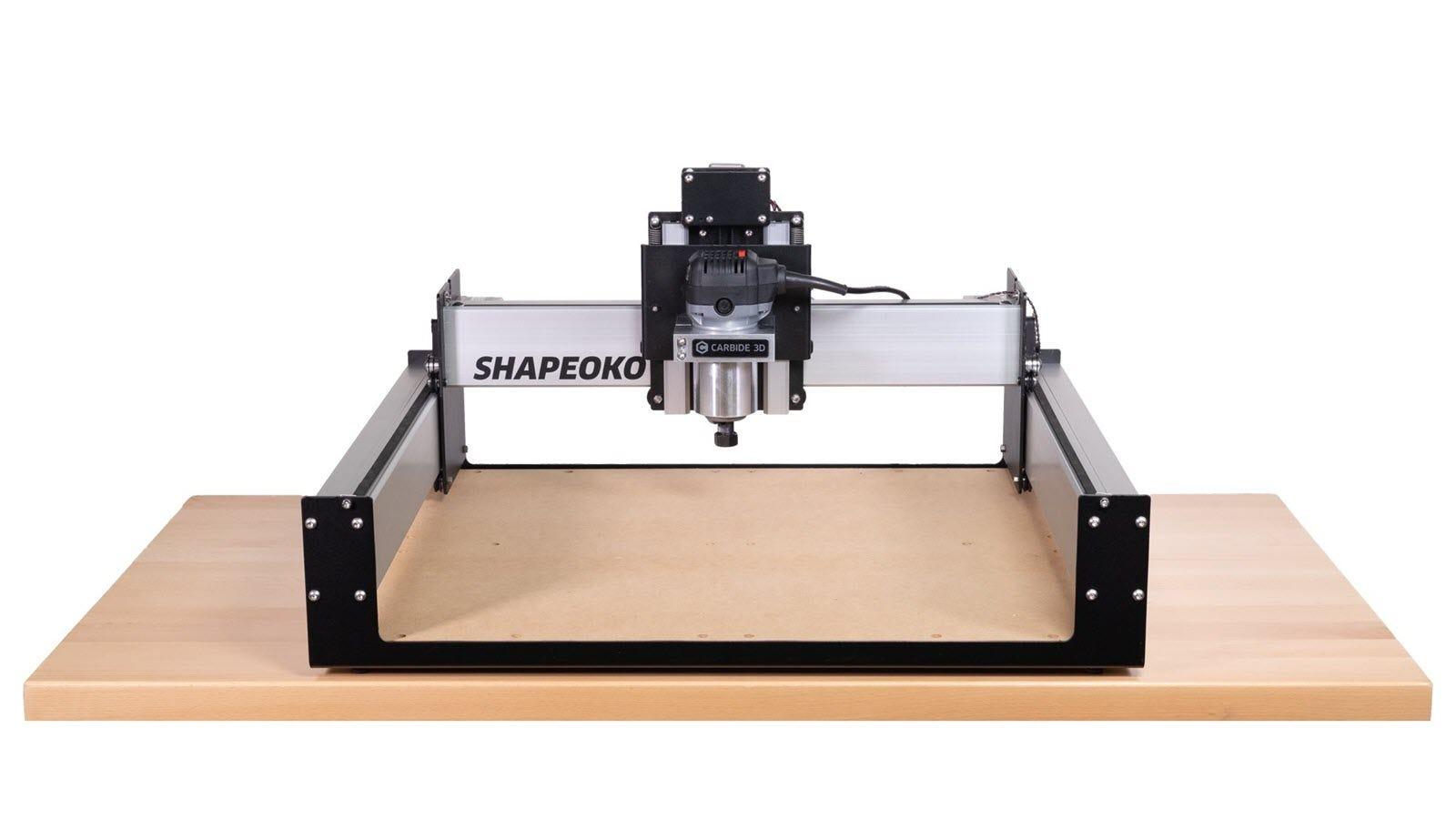 The Shapeoko 3 CNC machine sitting on a large wooden platform.
