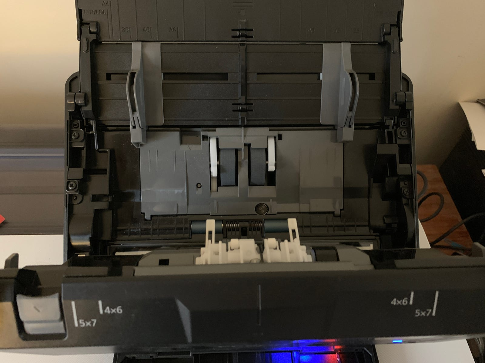 The Epson FastFoto FF-680W scanner with its front panel open.