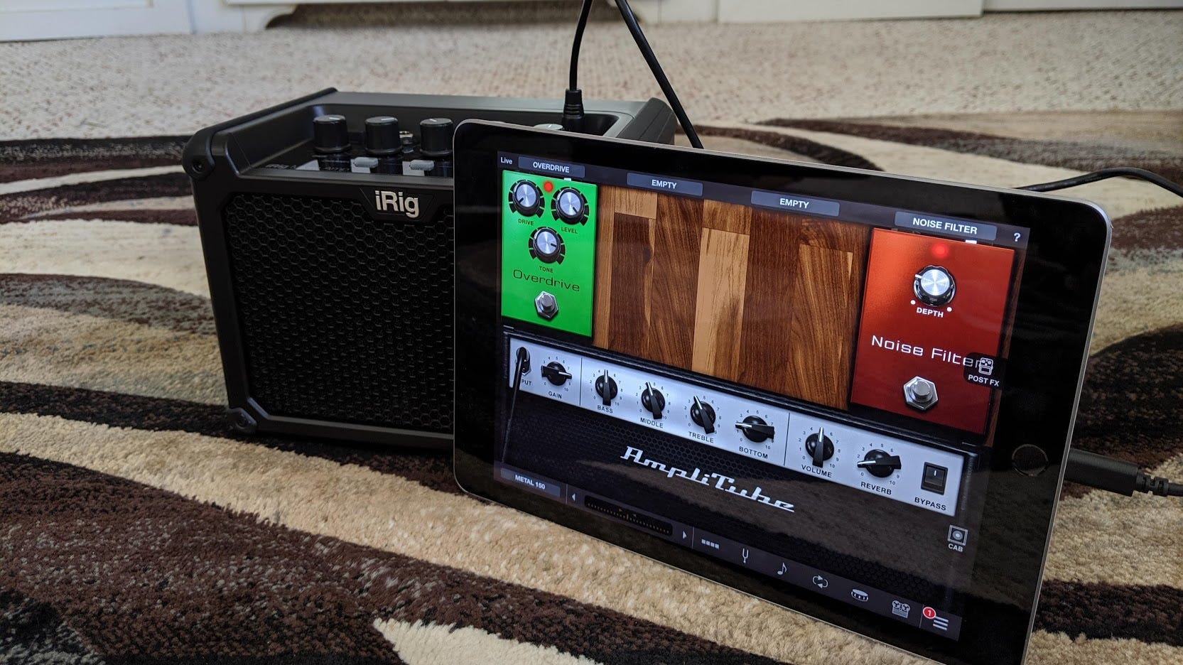 The iRig Micro Amp with Amplitube running on an iPad